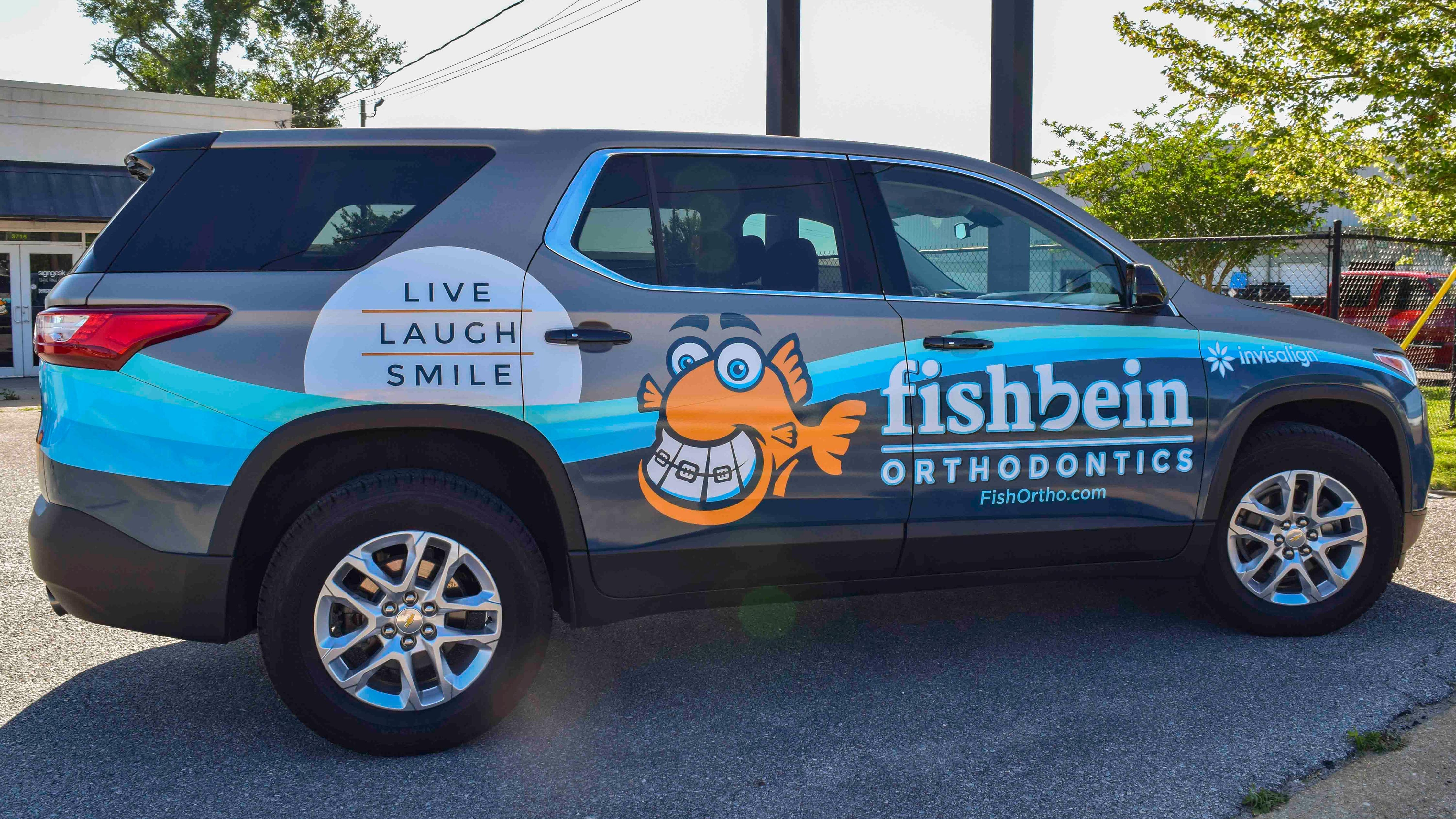 Vehicle wrap for Fishbein Orthodontics - Pensacola Sign vehicle wraps