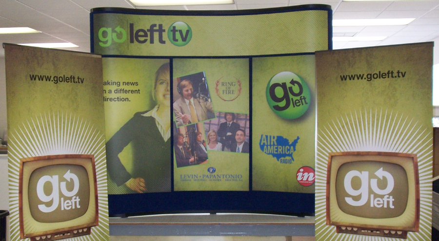 Four-color trade show booth with pop-up banners by Pensacola Sign