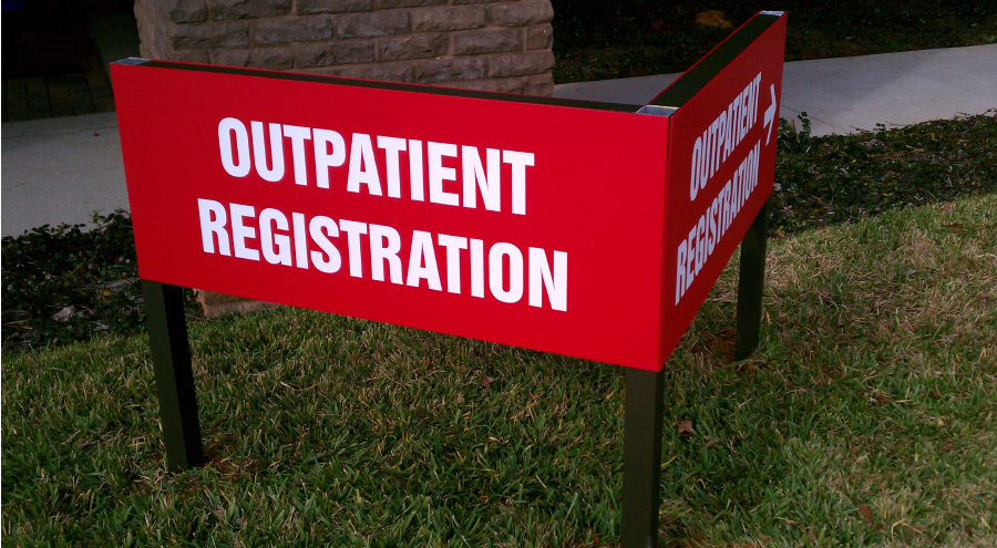 Exterior wayfinding outpatient registration signage by Pensacola Sign
