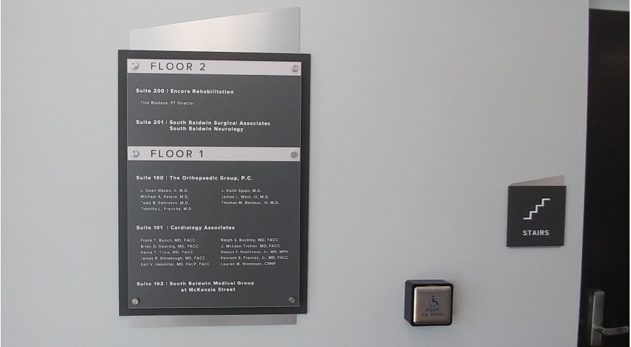 Custom interior wayfinding floor directory signage by Pensacola Sign