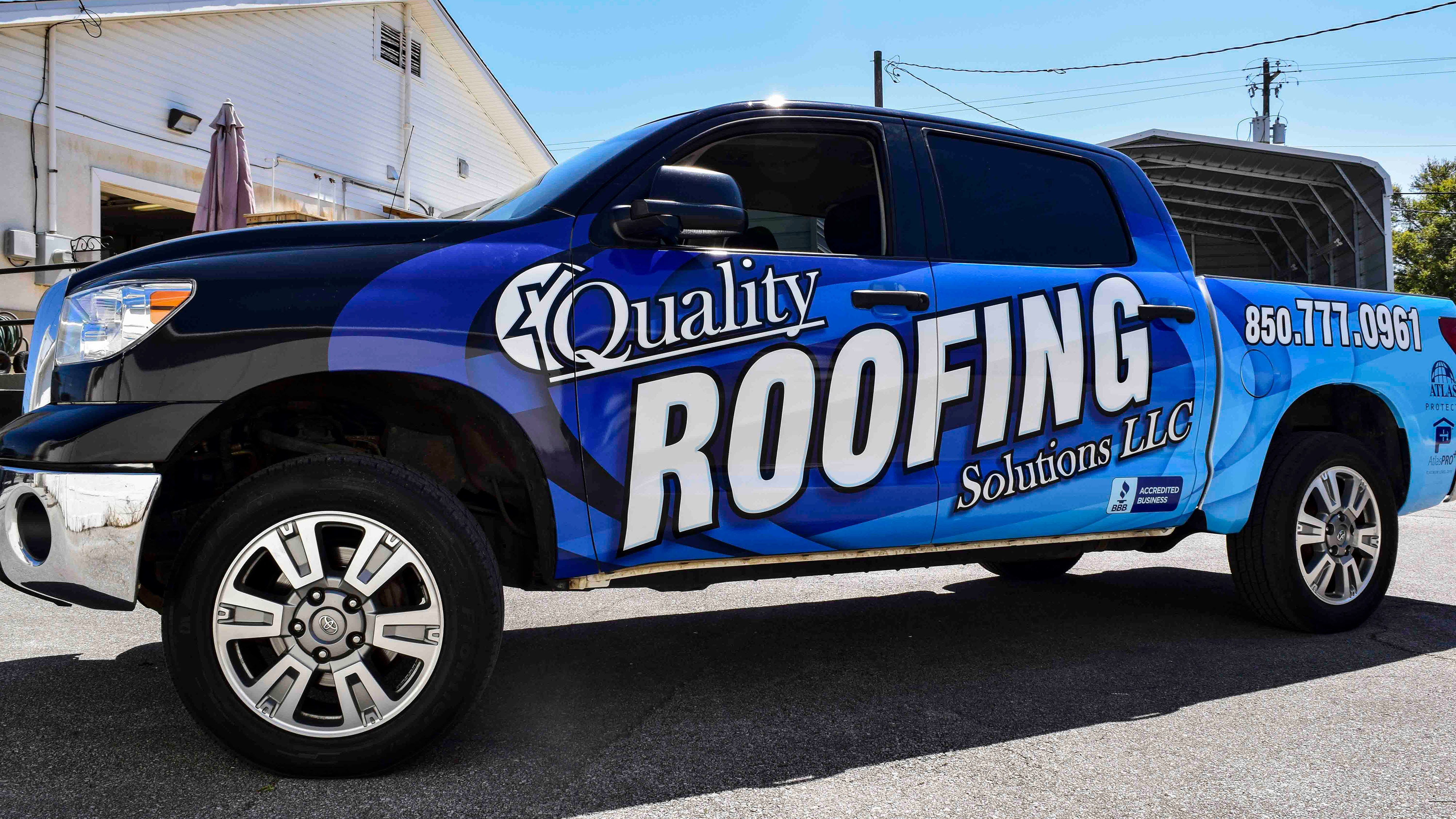 Vehicle wrap for Quality Roofing Solutions truck - Pensacola Sign Vehicle Wraps