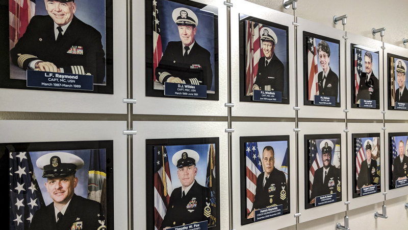 Custom built hanging hallway photo display for Naval Hospital Pensacola by Pensacola Sign