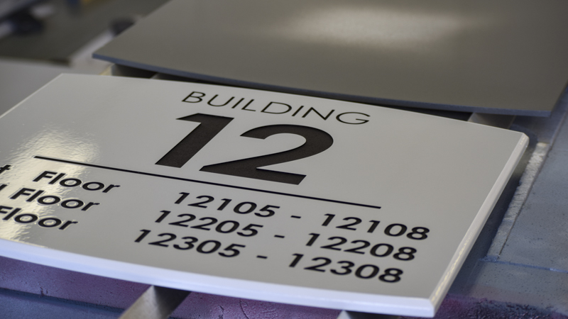 Apartment building exterior wayfinding by Pensacola Sign