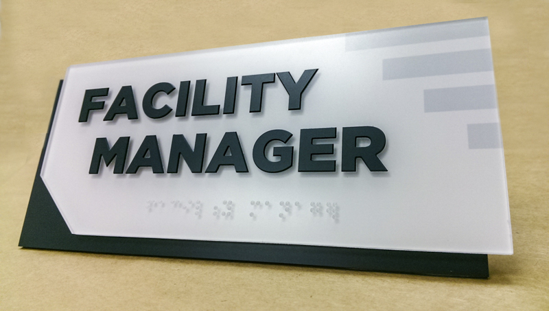 Facility manager ADA compliant wayfinding by Pensacola Sign