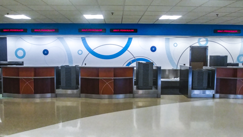 Pensacola International Airport ticket counter wall wrap - Pensacola Sign Wall Wraps