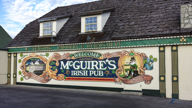 McGuire's Irish Pub wall wrap - Pensacola Sign Environmental Graphics