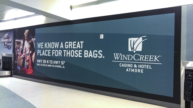 Pensacola International Airport baggage claim billboard wrap - Pensacola Sign Environmental Graphics