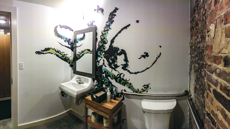 Bathroom gyotaku art wall mural for Nom Sushi Izakaya - Pensacola Sign Environmental Graphics