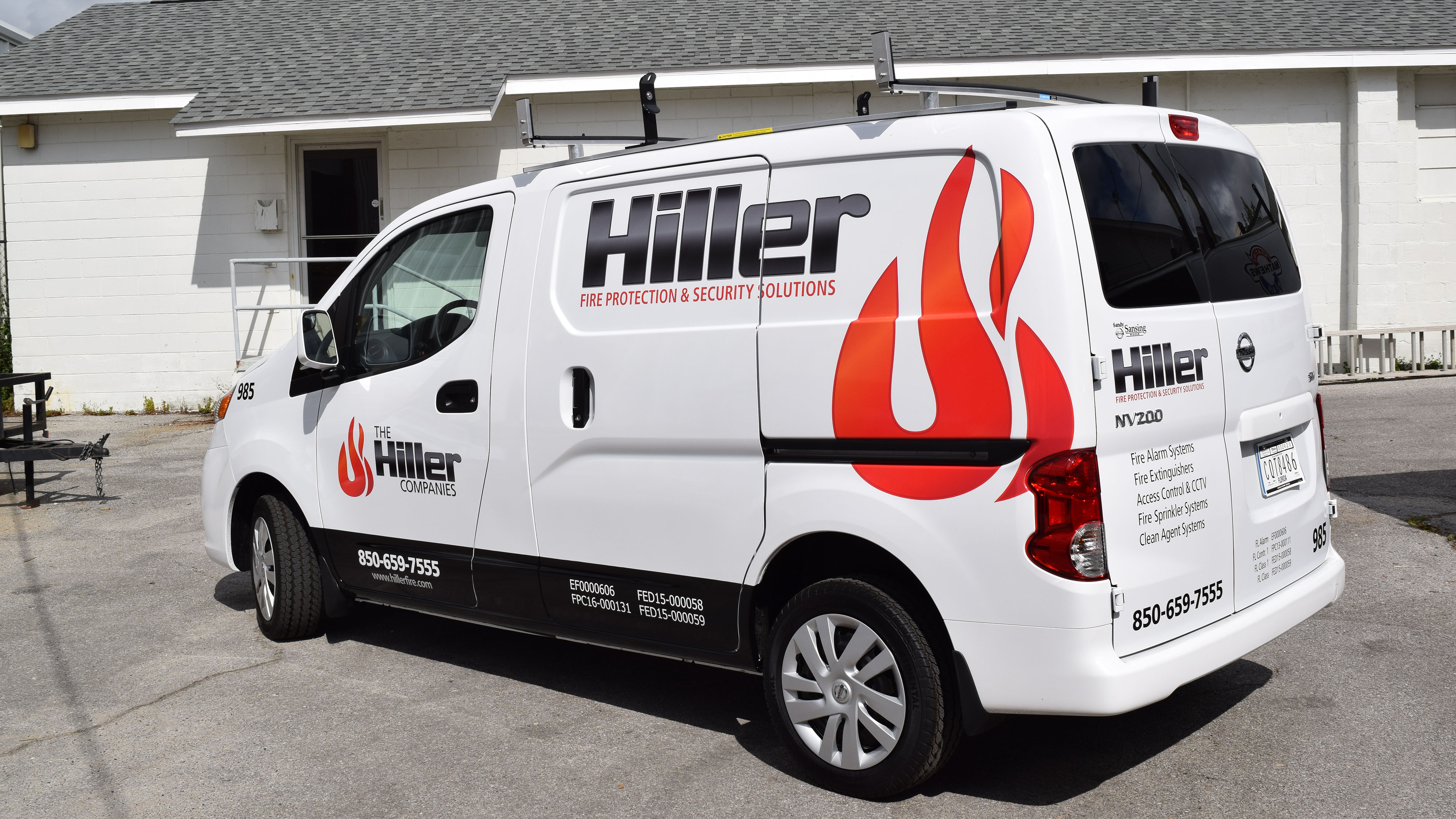 Vinyl fleet graphics on white Hiller company van by Pensacola Sign