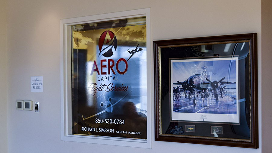 Aero Capital window graphic vinyl lettering and decals by Pensacola Sign