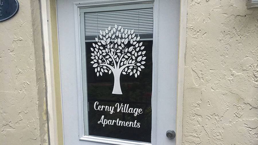 Cerny Village Apartments vinyl lettering and decals by Pensacola Sign